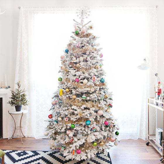 Flocked Christmas Tree with Vintage Ornaments via Melodrama